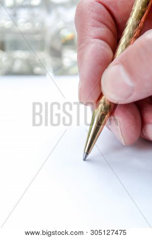 Man Writing With Pen On Paper, Close Up Of Hand Hollding Pen To Write On Paper Document