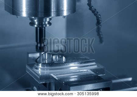The Cnc Milling Machine Cutting The Mold Parts With The Solid Ball End-mill Tool. The Machining Cent