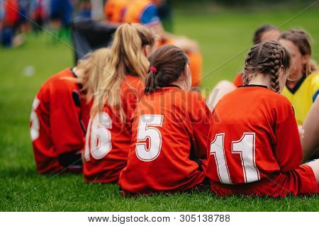 Girls In Sports Soccer Team Outdoors. Female Physical Education Class On Sports Grass Field. Young F