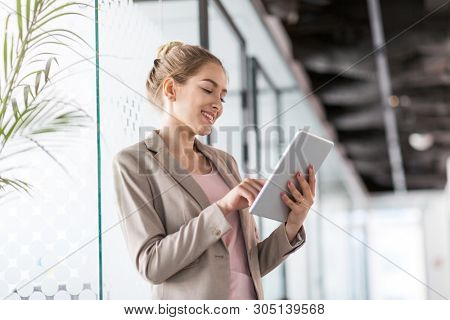Business woman using digital tablet in office
