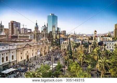 Santiago, Chile- Dec 29, 2018: View at Plaza de Armas and Metropolitan Cathedral of Santiago in Chile. Metropolitan Cathedral of Santiago is the seat of the Archbishop of Santiago de Chile.