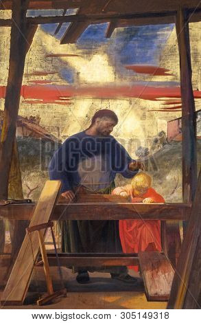 FLORENCE, ITALY - JANUARY 11, 2019: Altarpiece of saint Joseph the Worker, by Pietro Annigoni in the Basilica di San Lorenzo in Florence, Italy