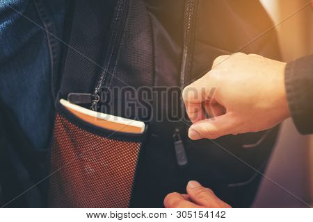 Thief Trying To Steal The Wallet In The Backpack, Stealing Traveling Bag On Street In Big City, Crim