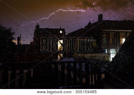 Drops Of Rain On A Windowpane, Window Rain Blurred City Lights, Rain Drop In The Window At Night. Ra