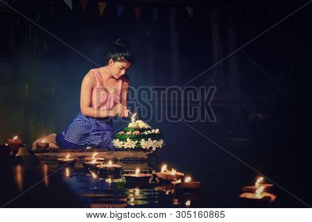 Loy Krathong Traditional Festival, Thai Woman Dress Traditional Sitting Hold Kratong And Light The C