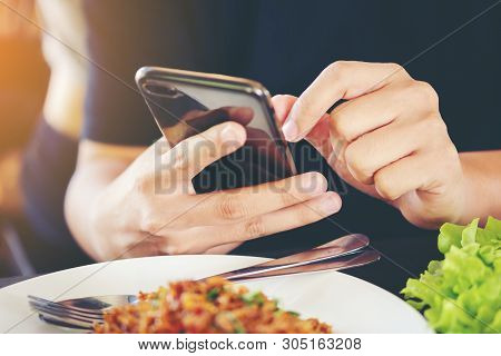 Close-up Man's Hands Use Pointing Finger Mobile Smart Phone On Food Table, Technology And Home Conce