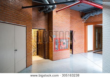 Modern Building Interior With Old Vintage Brick Wall. Hallway Of Modern Office, School, Hospital.for