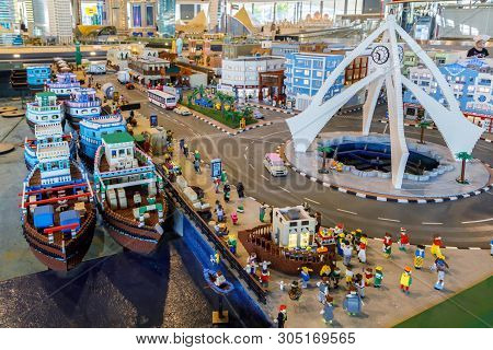 Dubai, Uae, January 09, 2019: Miniature Of The Sea Harbor With Ships, Moorings And All Infrastructur
