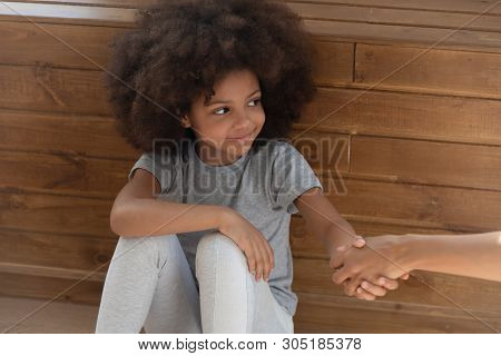 Happy Small Kid Girl Orphan Holding Hand Of Foster Parent
