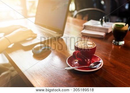 Woman Working With Laptop Computer, Hand Women Working On Laptop With Coffee On Wooden Desk, Close U