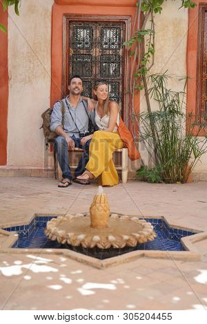 Couple sitting in beautiful Moroccan riad poster