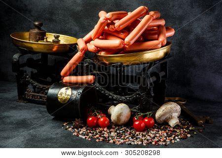 Heap Of Delicatessen Long Thin Wieners On Antiquarian Scales