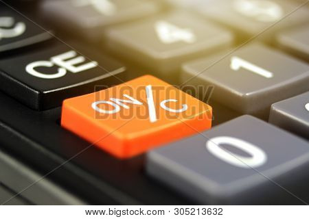 Close Up Orange Power Button (on/c) In Calculator.