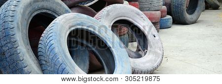A Picture Of Many Old Used Tires Left On A Waste Dump