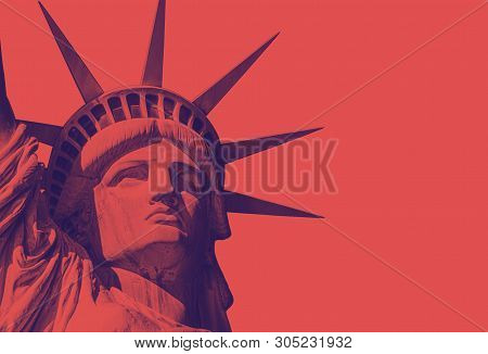 Detail Of The Face Of The Statue Of Liberty With A Red Duo Tone Effect. Red Background