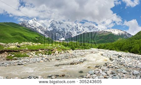 Caucasus Mountains Nature Landscape With Mountain River. Beautiful View On Caucasus Mountains In Geo