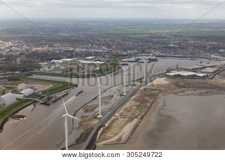 Aerial View Harbor Delfzijl With Wind Turbines And Factories In The Netherlands