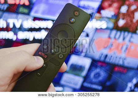 Sankt-petersburg, Russia, March 30, 2019: Man Holds In His Hand Remote Control With Netflix Button.