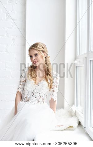 Beautiful Bride With Fashion Wedding Hairstyle - On White Background.closeup Portrait Of Young Gorge