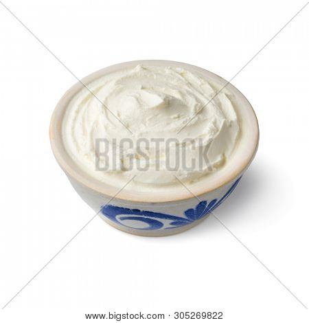 Bowl with fresh white cheese, called fromage blanc in France, used as a spread isolated on white background