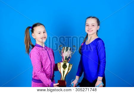 Happy Children With Gold Champion Cup. Team Victory. Sport Success. Acrobatics And Gymnastics. Littl
