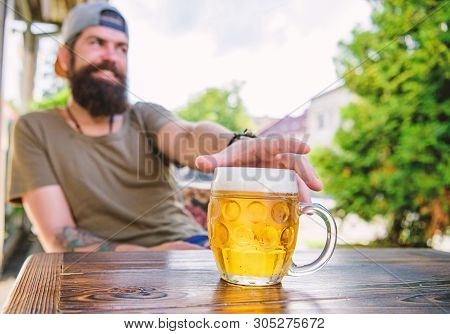 He Has The Bad Habit Of Drinking Too Much Beer. Chilled Beer Mug On Table. Bearded Man Drinking Beer