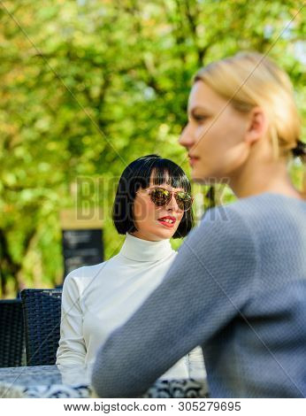 Friendship Or Rivalry. Trustful Communication. Girls Friends Drink Coffee Talk. Conversation Of Two