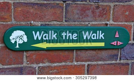 A sign telling visitors which way to walk at Arley Arboretum in the Midlands in England. poster
