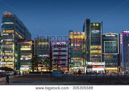 Busan, South Korea - April 2019: Illuminated Lights On Business Buildings During Nighttime At Gwanga