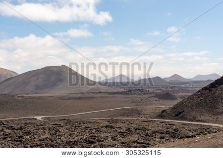 Roads In Amazing Volcanic Landscape Of Timanfaya National Park, Lanzarote, Canary Islands, Spain