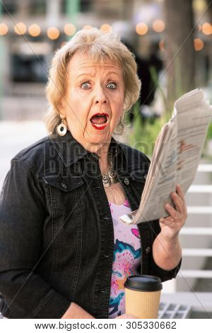 Woman Downtown With Newspaper Reacting To Story