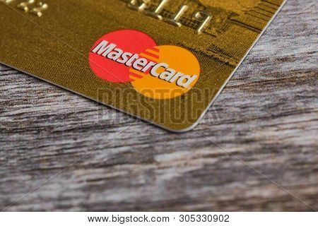 Mainz, Germany - June 07, 2019: Credit Card With Mastercard Logo On Wooden Background. Mastercard Is