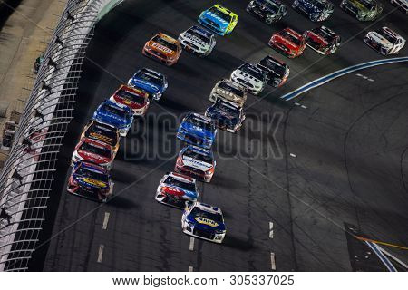 May 26, 2019 - Concord, North Carolina, USA: Martin Truex Jr. (19) and Chase Elliott (9) race for the lead during the Coca-Cola 600 at Charlotte Motor Speedway in Concord, North Carolina.