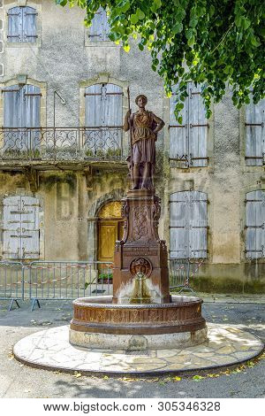Statue In The French Village Square Of Alet Les Bains In Aude, Occitania In The South Of France