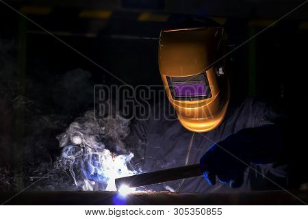 Working Person About Welder Steel Using Electric Welding Machine There Are Lines Of Light Coming Out
