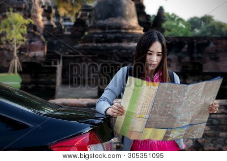 Tourist Women With Carrying A Backpack Viewing Map, About The Temple In Ayutthaya .concept Find Attr