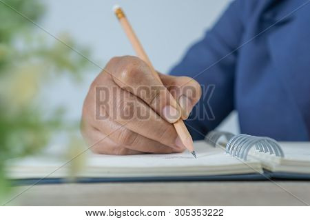 Adult Learning For Student University Study In Class, Hand Note Lecture In Notebook For Exam. Adults