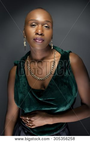 Beautiful Black African American Female Model Posing Confidently With Bald Hairstyle In A Studio.  T