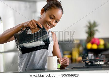 Indonesian woman making coffee in modern Indonesian woman making coffee
