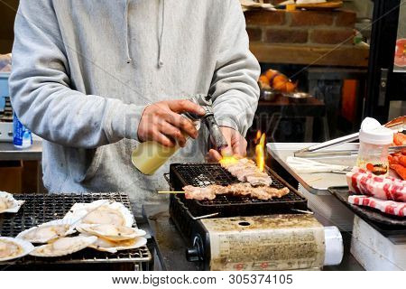 Hand Of Chef Using Burner Cooking And Burn Kobe Beef Wood Stick On Stove To Sale For Customer At Kur