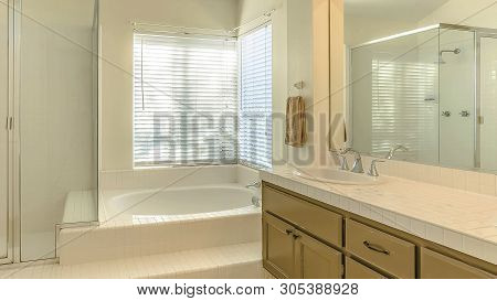 Panorama Frame Bathtub And Double Vanity Unit Inside The Well Lighted Bathroom Of A Home