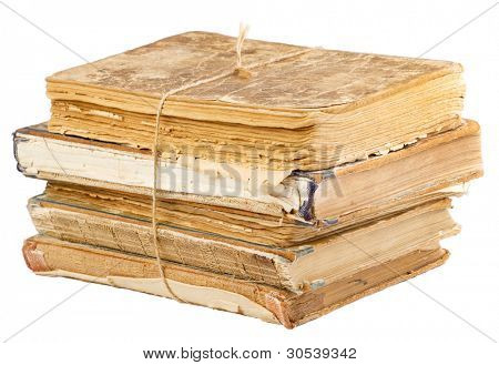 Stack of old books tied with rope isolated on white