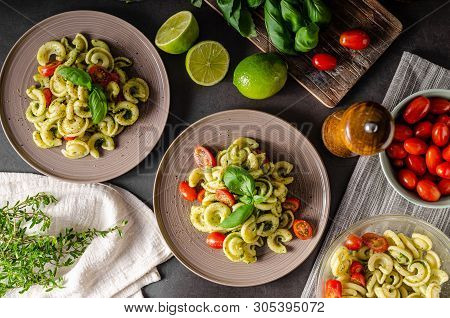Homemade Pasta With Fresh Basil Pesto And Tomatoes