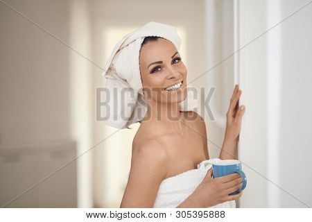 Happy Smiling Beautiful Middle-aged Healthy Woman Wearing Fresh Clean White Towels Around Her Hair A