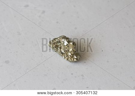 Beautiful Iron From Natural Pyrite. On A White Background. Golden And Golden Stone Or Pyrite. Natura