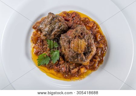 Dish With Portion Of Oxtail Stewed Vaccinara With Parsley