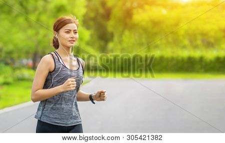 Young Fitness Sport Woman Running On The Road In The Morning, Young Fitness Sportswoman Runner Runni