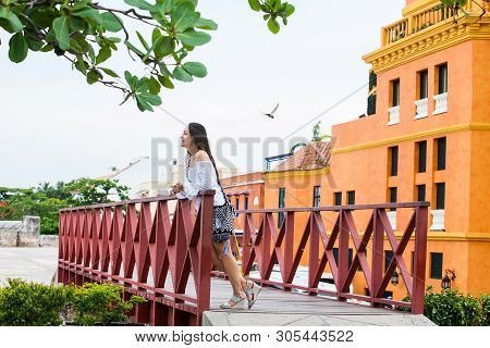 Beautiful Woman On White Dress Standing Alone At The Walls Surrounding Of The Colonial City Of Carta