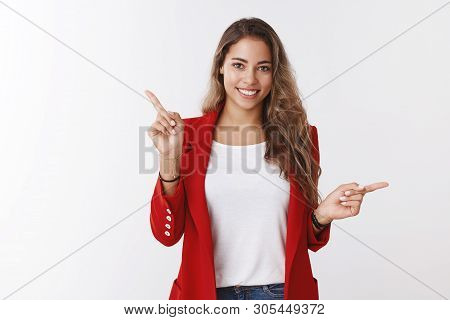 Studio Shot Attractive Friendly Smiling Happy Caucasian 25s Woman Wearing Red Jacket Pointing Sidewa