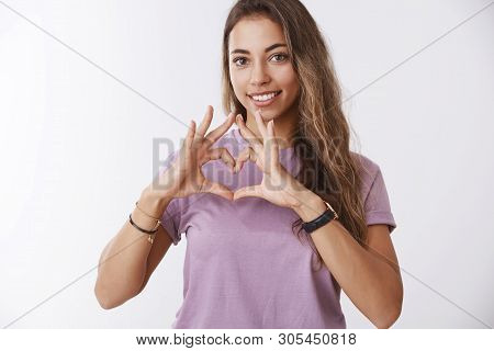 Tender Charming Smiling Young Girl Looking Joyfully Showing Heart Gesture Confessing Love, Heartwarm